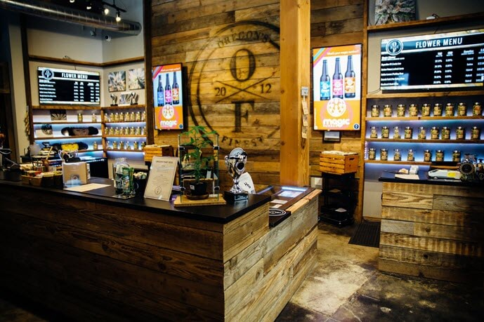 the interior of the oregon's finest pearl location showing the product cases, counters, and the barnwood interior