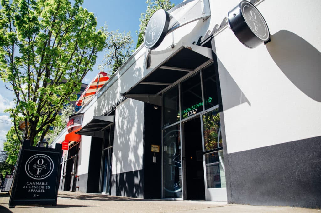 a black and white building housing the oregon's finest pearl district marijuana dispensary on a sunny day